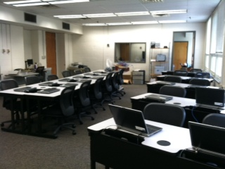 Rows of tables and computers in the AT lab